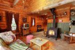 Chalet à louer Refuge Salon avec poêle à bois - Chalet Refuge