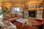 Chalet à louer Nirvana Salon avec foyer au gaz - Chalet Nirvana