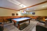 Chalet à louer Huard Salle de jeux au sous-sol - Chalet Huard